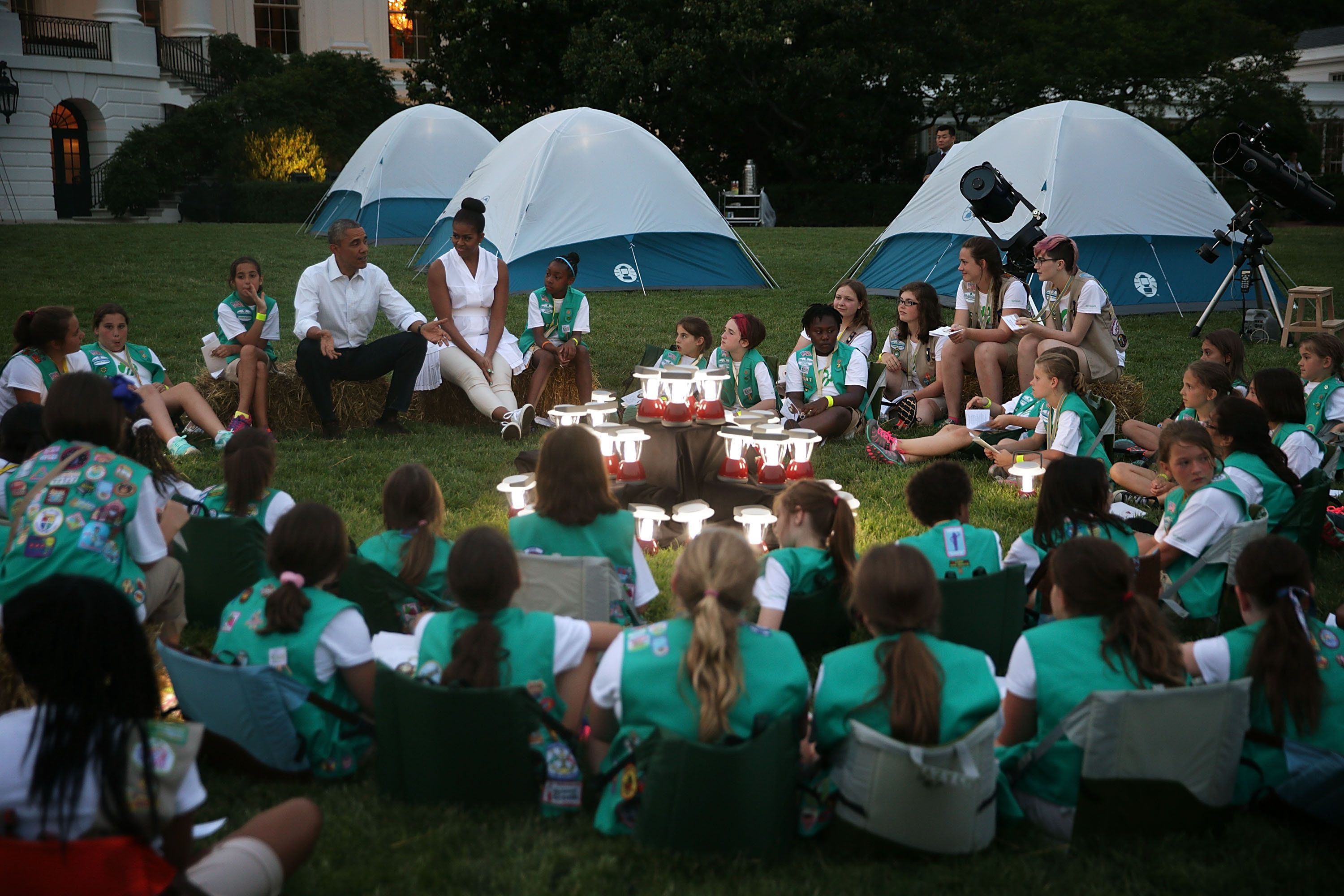 WASHINGTON, DC - JUNE 30:  U.S. President Barack Obama and first lady Michelle Obama particiapte in campfire songs session with fourth-grade Girl Scouts during the first-ever White House Campout June 30, 2015 at South Lawn of the White House in Washington, DC. The first lady hosted the event, as part of her Let's Move! Outside initiative, for Girl Scouts to participate in activities to earn their Camper Badge, and to celebrate the release of the new Girls' Choice Outdoor badges.  (Photo by Alex Wong/Getty Images)