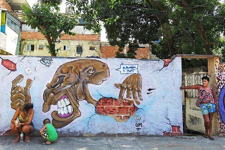 Chilean artist Edie. Meeting Of Favela 2016. Favela Operaria. Duque de Caxias. Rio De Janeiro, Brazil.