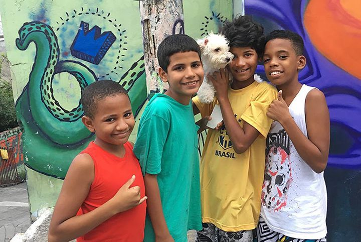 Young boys and their dog. Meeting Of Favela 2016. Favela Operaria. Duque de Caxias. Rio De Janeiro, Brazil.