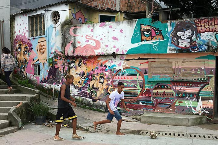 Soccer in Vidigal Favela with a mural by Andre Kajaman (one of the MOF founders) and Tarm1. Rio De Janeiro, Brazil.