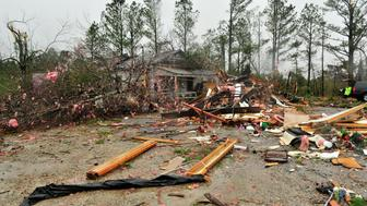 ROSALIE, AL - NOVEMBER 30: Crews stand by the site where three people were killed and one critically injured in their mobile home as the tornado swept through the small Sand Mountain town on November 30, 2016 in Rosalie, Alabama. (Photo by Eric Schultz/Getty Images)