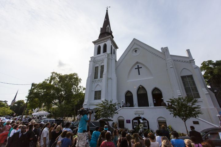 "Mourners gather in front of Emanuel African Methodist Episcopal Church,where Dylann Roof murdered nine black people. ""In"