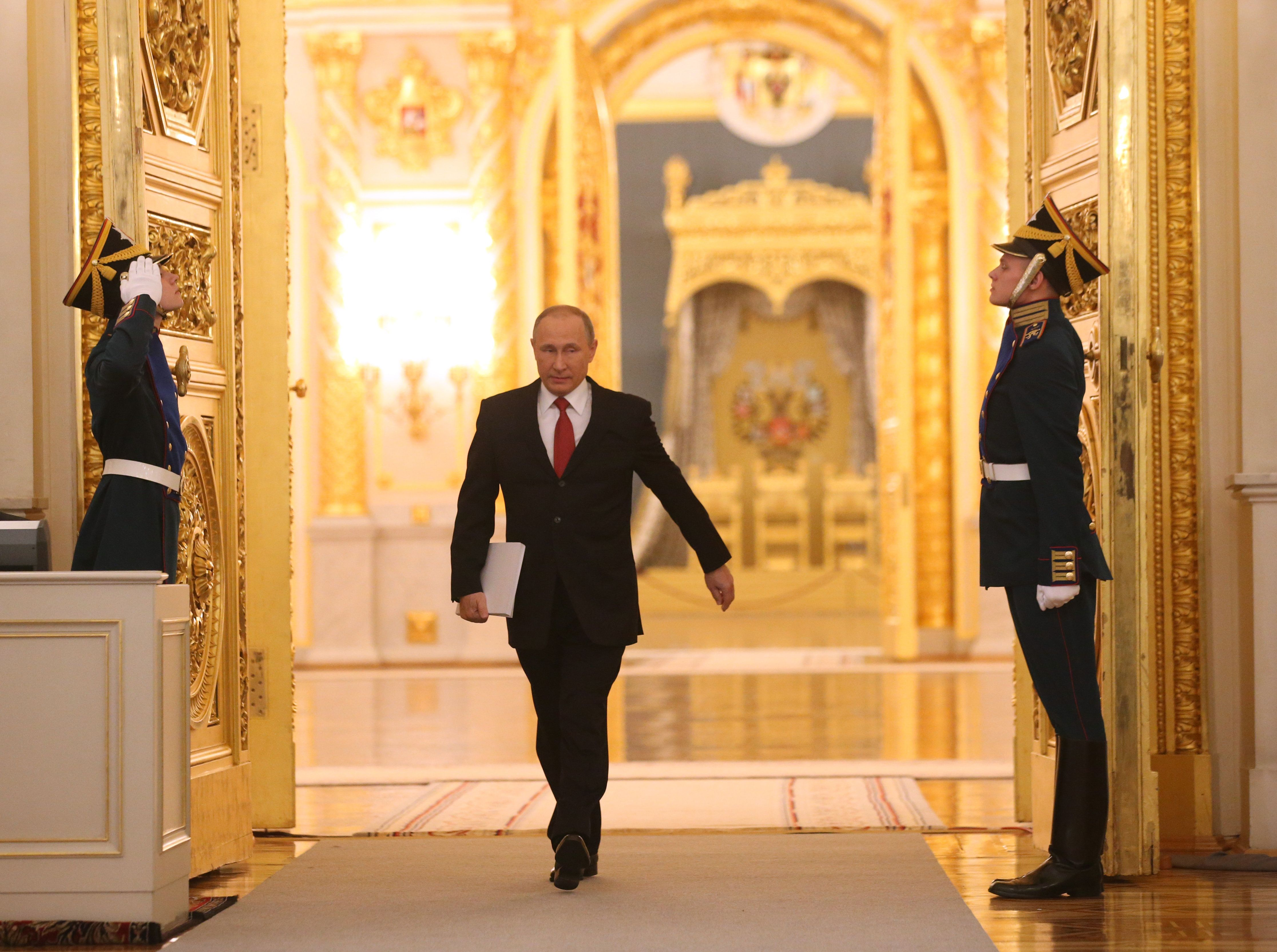RUSSIA, MOSCOW - DECEMBER 1:   (RUSSIA OUT) Russian President Vladimir Putin enters the hall to deliver his annual speech to the Federal Assembly at Grand Kremlin Palace on December, 1, 2016 in Moscow, Russia. Putin spoke favorably towards future bilateral ties with the US once Donald Trump takes office in January.  (Photo by Mikhail Svetlov/Getty Images)