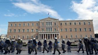 Greek police forces take position outside the parliament building in central Athens during a commemoration rally by students on December 6, 2016.  Hundreds of high school and university students participated in a rally to mark the eighth anniversary of the fatal police shooting of 15-year-old student Alexandros Grigoropoulos, sparking riots across the country in 2008. / AFP / LOUISA GOULIAMAKI        (Photo credit should read LOUISA GOULIAMAKI/AFP/Getty Images)