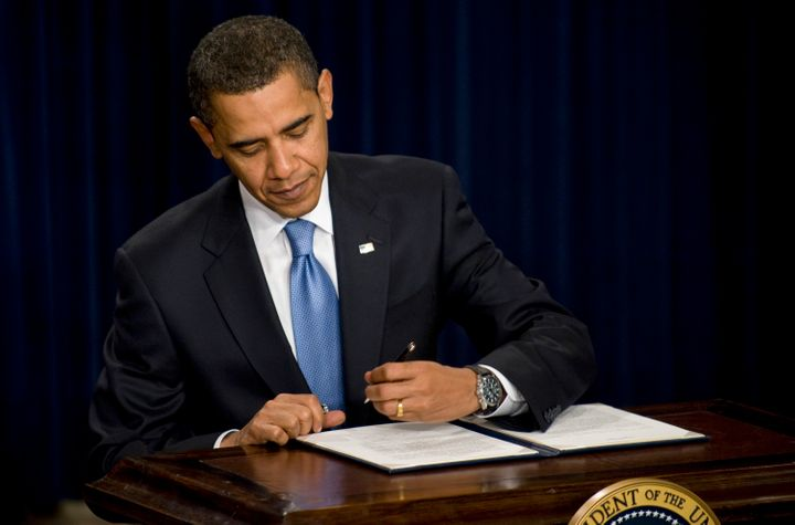 President Barack Obama signs an executive order on ethics for his senior staff during a meeting in the Eisenhower Executive Office Building, adjacent to the White House, in Washington, D.C. on Jan. 21, 2009.