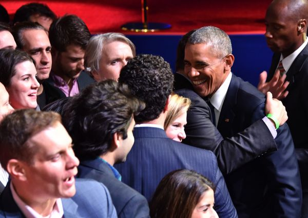 Obama hugs supporters after his farewell address.