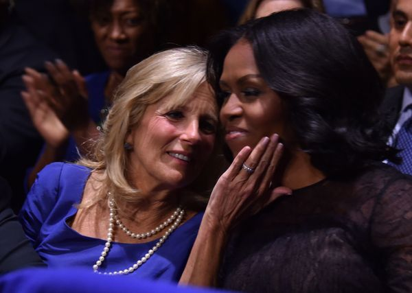 Michelle Obama (right) and Dr. Jill Biden, wife of Vice President Joe Biden, hug as President Obama speaks.
