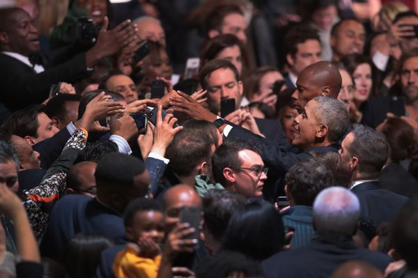Obama greets guests following his speech.
