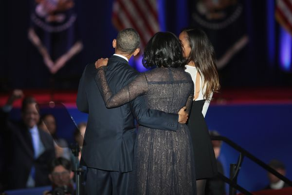 The Obama family embraces on stage following Barack Obama's farewell address.