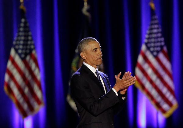 Obama applauds his supporters at the end of his farewell address.