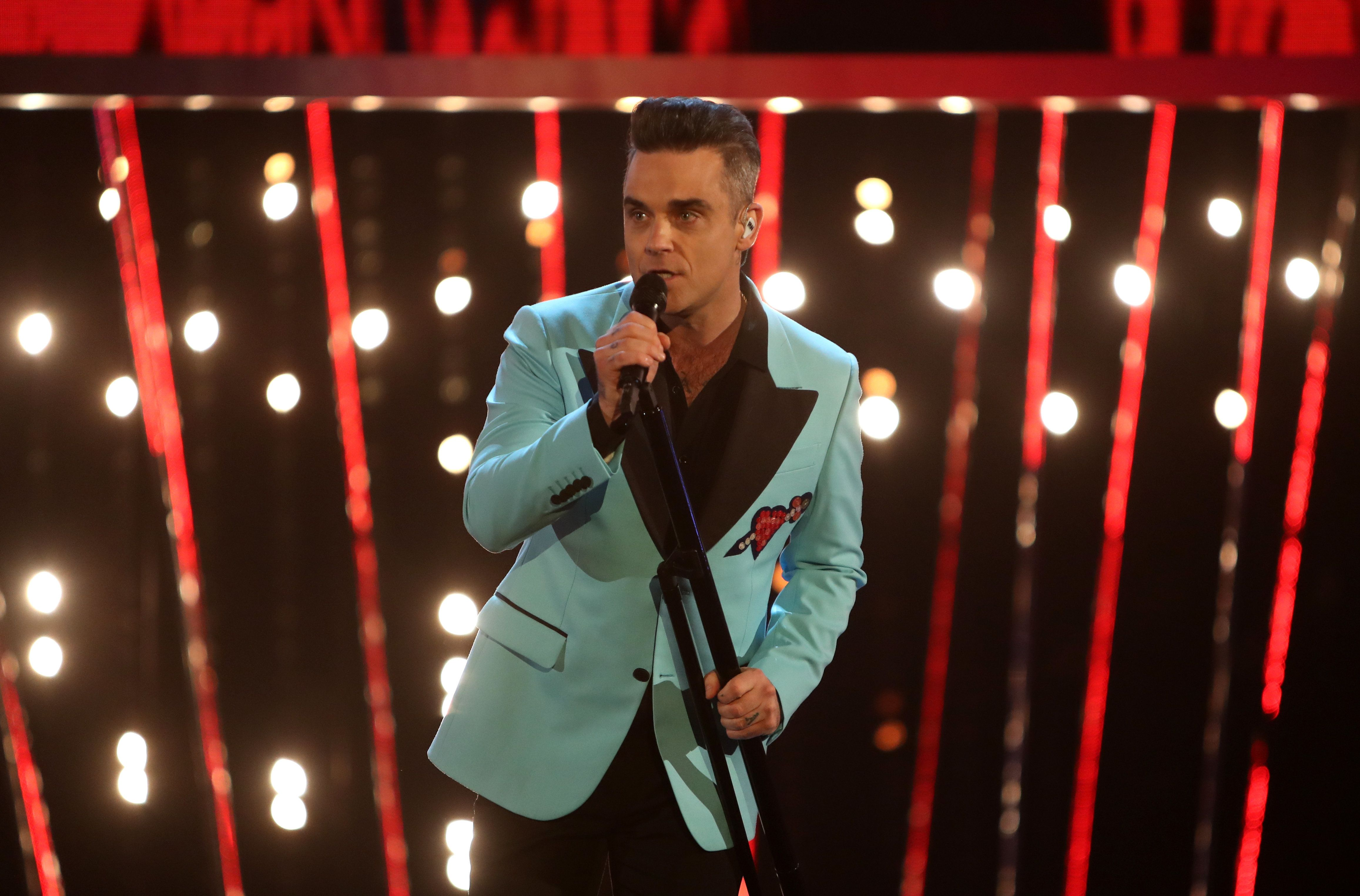 Robbie Williams' Management Team Accused Of Selling Tour Tickets On Resale Sites At Inflated