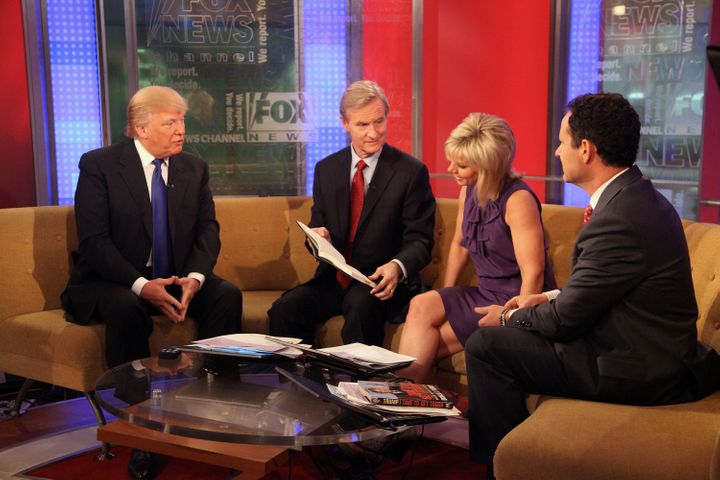 "Gretchen Carlson interviews Donald Trump in 2011 with ""FOX & Friends"" co-hosts Steve Doocy and Brian Kilmeade."