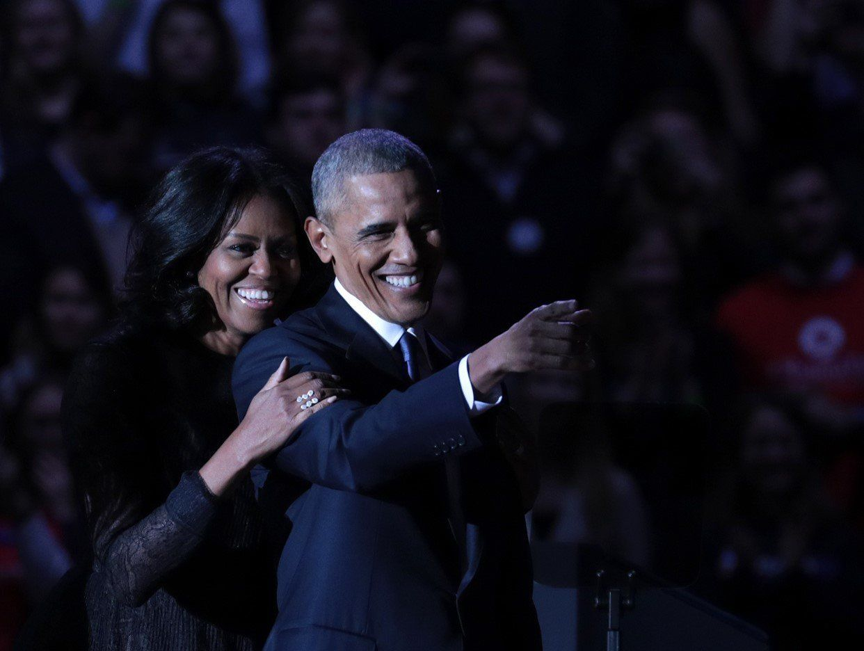 President Barack Obama and first lady Michelle Obama on stage after the president delivered his farewell...