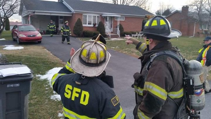Fire Chief Randy O'Donnell of Shippensburg, Pennsylvania, left, discusses the plan for clearing smoke from a house. All-volun