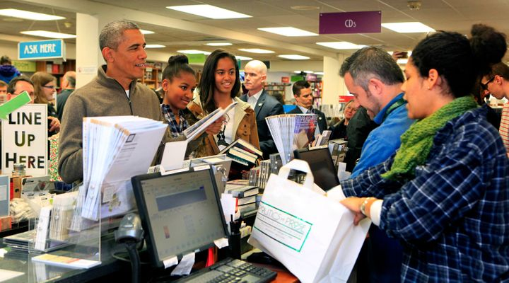 President Obama shopping for books at local D.C. bookstore Politics and Prose in 2014.