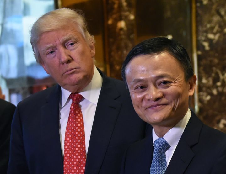 Jack Ma (R), founder and executive chairman of Alibaba Group, and President-elect Donald Trump pose for the media after their