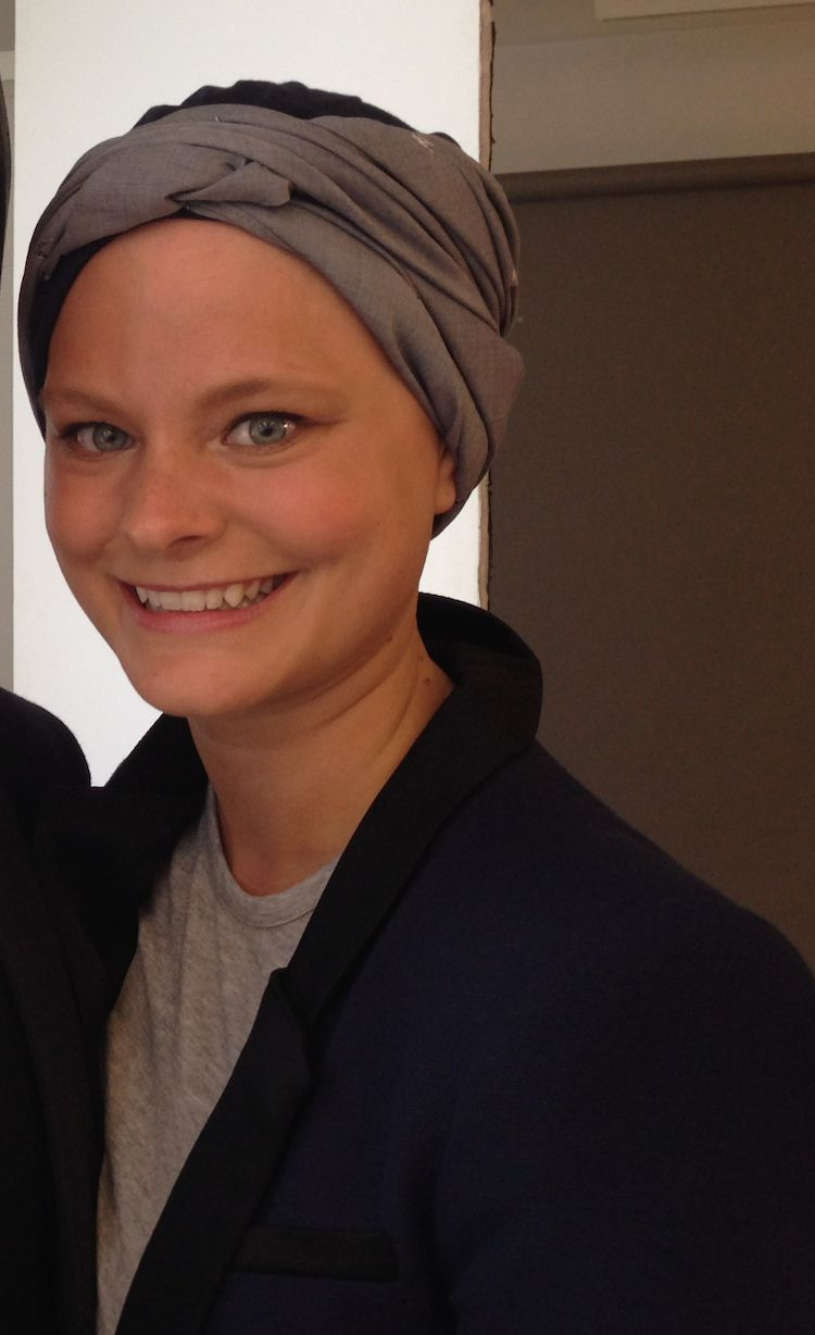 Transitions Hair Solutions client Malin Mumford stylishly wears a headscarf.