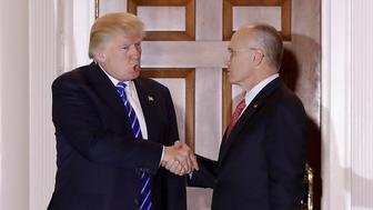 FILE - In this Saturday, Nov. 19, 2016, file photo, President-elect Donald Trump and Andy Puzder, chief executive of CKE Restaurants, shake hands as Puzder leaves Trump National Golf Club Bedminster clubhouse in Bedminster, N.J. Trump has tapped Puzder as his pick to head the Labor Department. Trumps election as president has made many small business owners more upbeat about 2017. Many owners are more confident because their revenue looks to increase in 2017 due to the overall improving economy. Theyre also optimistic because they expect Trump to deliver on promises to lower taxes and roll back regulations including parts of the health care law. (AP Photo/Carolyn Kaster, File)