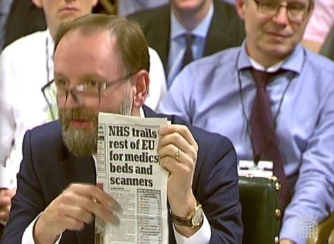 Simons Stevens holds up a Daily Mail