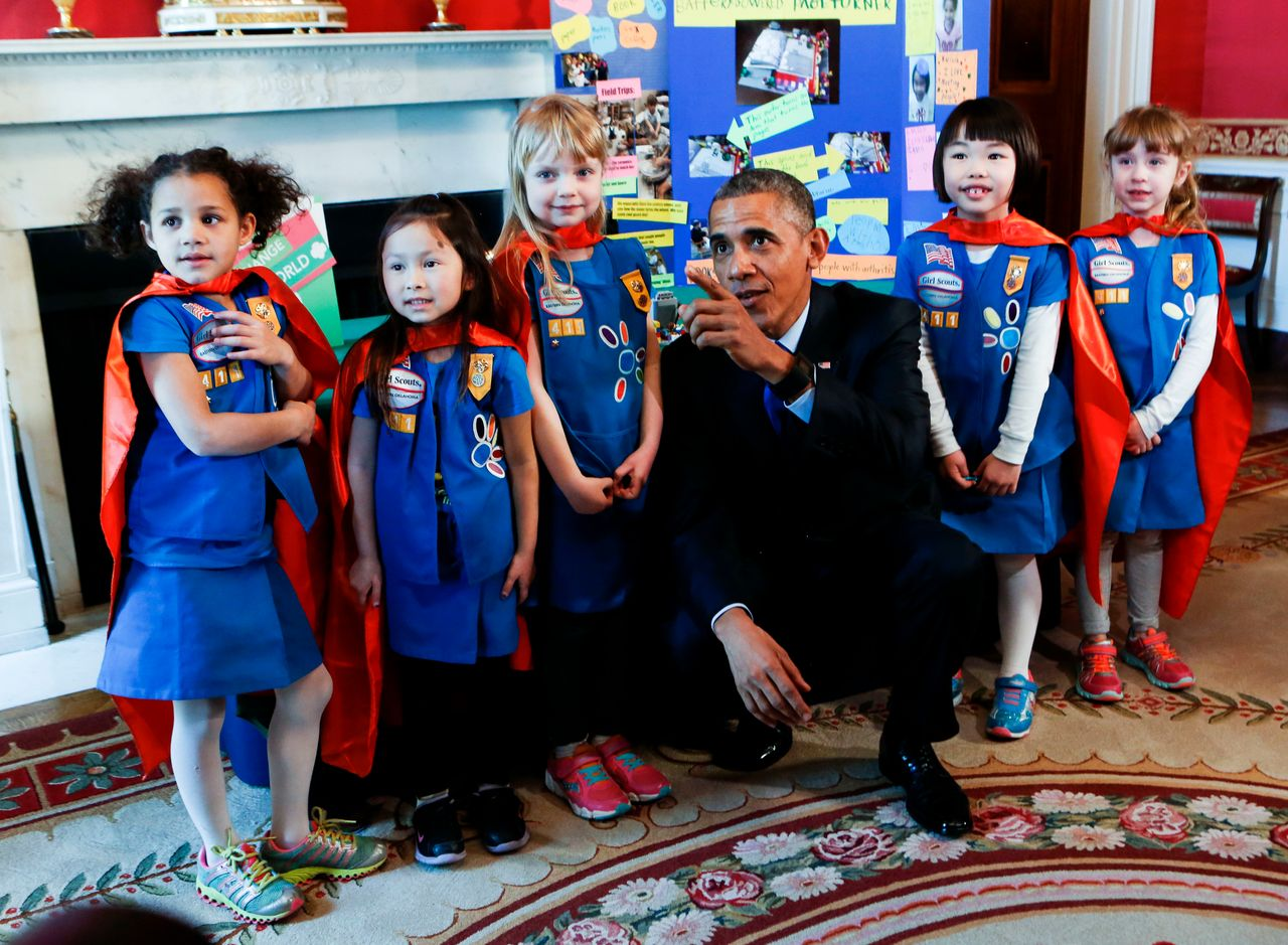 President Barack Obama poses with a group of 6 years old Girls Scouts from Tulsa Oklahoma who designed a battery powered page turner to help people who are paralyzed or have arthritis at the 2015 White House Science Fair.