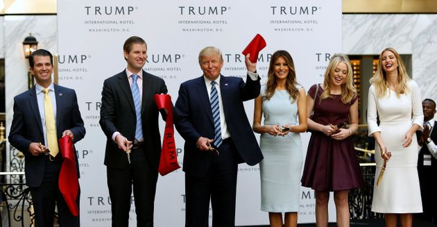 Donald Trump and his family attend an official ribbon-cutting ceremony at the new Trump International...