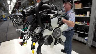 Chrysler Group assembly staff works on the engine of a 2014 Dodge Ram pickup truck at the Warren Assembly Plant in Warren, Michigan December 11, 2013. Chrysler Group LLC, which is owned by Fiat SpA, on January 29, 2014, said its revenue would rise 11 percent to about $80 billion in 2014. The American automaker that went through bankruptcy in 2009 and came out managed by Fiat, is now fully owned by the Italian company, which reported fourth-quarter earnings on Wednesday below expectations of analysts. Chrysler's fourth-quarter net income of $1.62 billion, up 329 percent from the previous year, included a $962 million non-cash tax benefit related to the release of a valuation allowances on deferred tax assets. Picture taken December 11, 2013.   REUTERS/Rebecca Cook (UNITED STATES - Tags: TRANSPORT BUSINESS EMPLOYMENT)