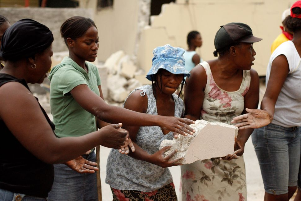 Women clear rubble in Port-au-Prince on Jan. 25, 2010.