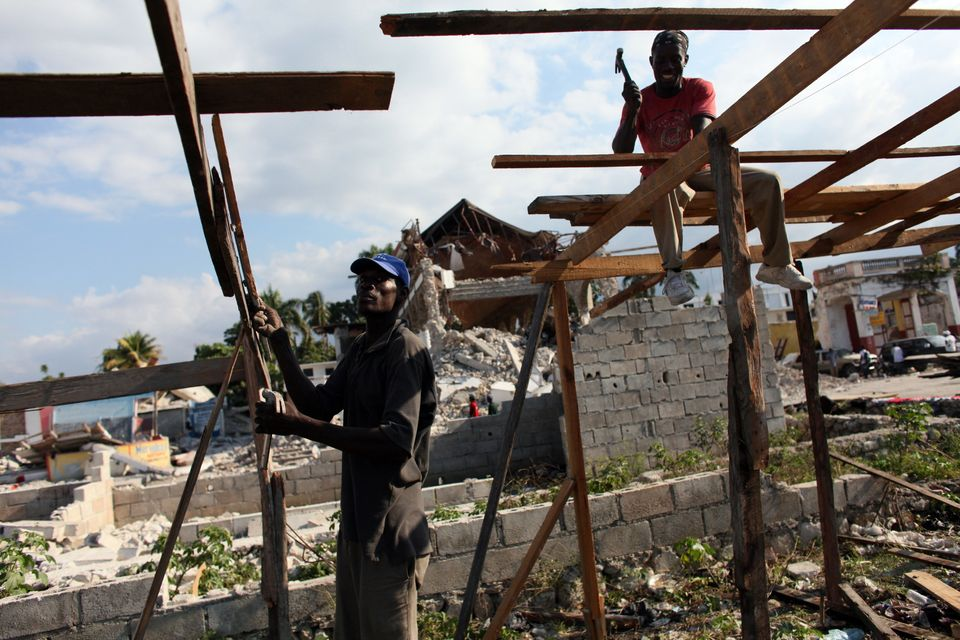 People build makeshift shelters in front of destroyed houses and a church in downtown Leogane, Haiti, on Jan. 16, 2010.
