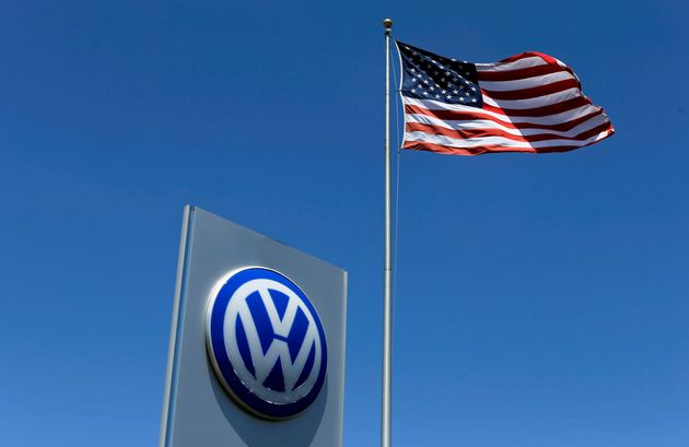 A U.S. flag flutters in the wind above a Volkswagen dealership in Carlsbad, California, U.S. May 2,