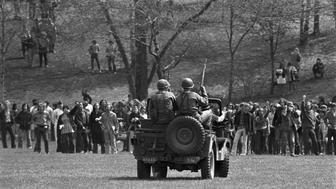 (Original Caption) Views at Kent State. Masked National Guardsmen fired a barrage of tear gas into a crowd of demonstrators on the campus of Kent State University May 4th. When the gas dissipated, four students lay dead and several others injured. Hundreds of students staged the demonstration in protest against the Nixon administration's expansion of the Vietnam War into Cambodia.