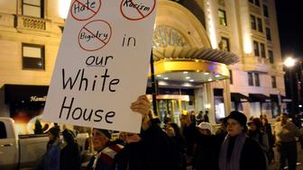 Demonstrators march against President-elect Donald Trump's election in downtown Washington, U.S., after leaving Lafayette Park near the White House, November 12, 2016.           REUTERS/Mike Theiler
