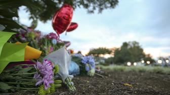 Flowers are seen at a memorial outside of the offices for WDBJ7 where slain journalists Alison Parker and Adam Ward worked in Roanoke, Virginia August 27, 2015. Parker, 24, and Ward, 27, were shot dead on Wednesday during a live segment for the CBS affiliate in Roanoke, Virginia, at a local recreation site about 200 miles (320 km) southwest of Washington. Another woman was wounded. The suspected gunman, 41-year-old Vester Flanagan, later died from a self-inflicted gunshot wound, authorities said. REUTERS/Chris Keane