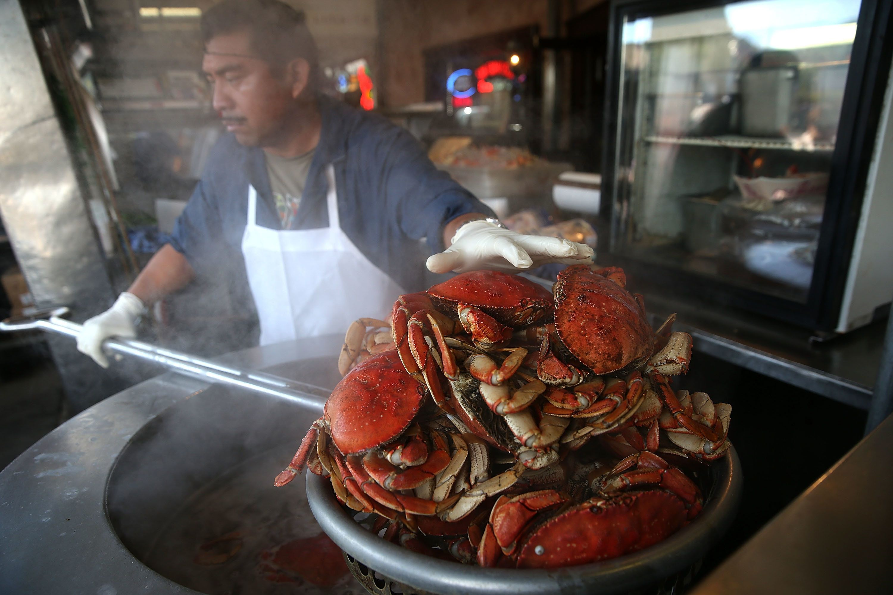 SAN FRANCISCO, CA - NOVEMBER 05:  A cook at Nick's Lighthouse prepares Dungeness crab on November 5, 2015 in San Francisco, California. The California Fish and Game Commission voted Thursday to suspend the recreational Dungeness crab fishing for 180 days due to the a high level of the deadly neurotoxin domoic acid that has been found in the meat and viscera of Dungeness crabs caught off the coast of San Francisco.  (Photo by Justin Sullivan/Getty Images)