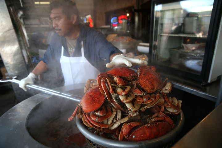 A cook at Nick's Lighthouse prepares Dungeness crab on November 5, 2015 in San Francisco, California. The California Fish and