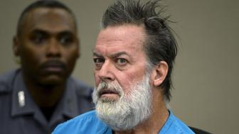 Robert Lewis Dear, 57, accused of shooting three people to death and wounding nine others at a Planned Parenthood clinic in Colorado last month, attends his hearing to face 179 counts of various criminal charges at an El Paso County court in Colorado Springs, Colorado December 9, 2015. REUTERS/Andy Cross/Pool