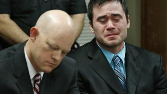 Daniel Holtzclaw, right, cries as the verdicts are read in his trial in Oklahoma City, Thursday, Dec. 10, 2015. At left is defense attorney Robert Gray. Holtzclaw, a former Oklahoma City police officer, was facing dozens of charges alleging he sexually assaulted 13 women while on duty. Holtzclaw was found guilty on a number of counts. (AP Photo/Sue Ogrocki, Pool)