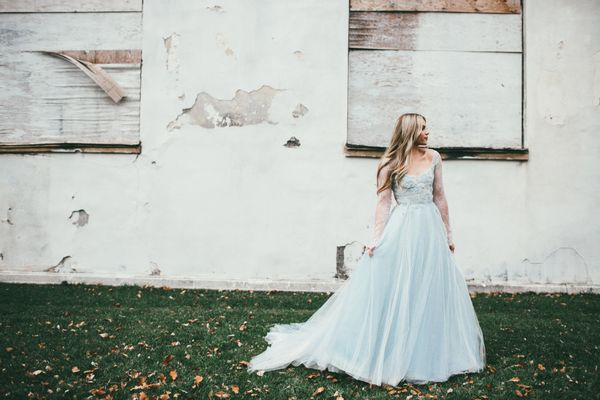 """<i>Gown by <a href=""""http://www.jeanandjewel.com/"""" target=""""_blank"""">Jean and Jewel</a></i>"""