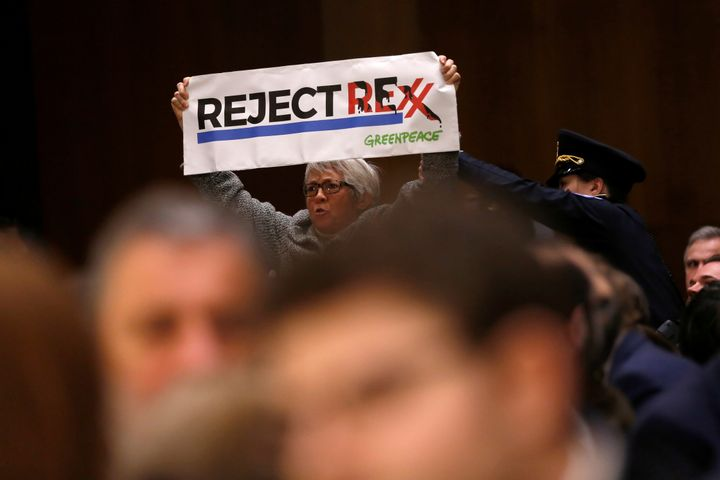 "Protesters interrupted the proceedings at least four times by holding up signs with the words ""Reject Rexx"""