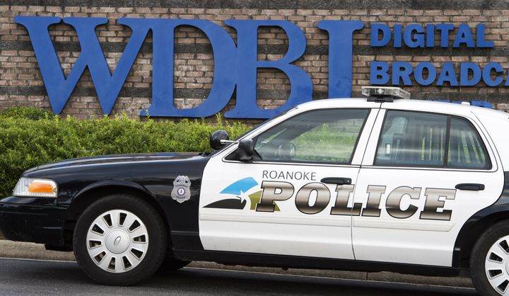 The Roanoke Police Department patrols at the gate of WDBJ's television studios August 27, 2015, in Roanoke, Virginia. Reporte