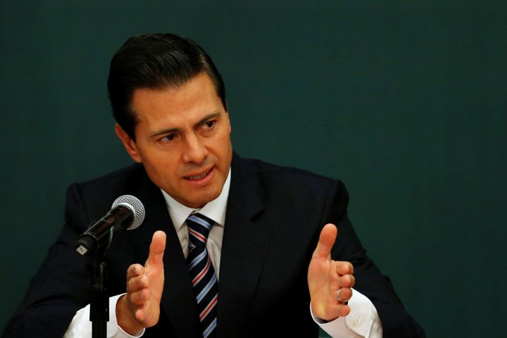 Mexico's President Enrique Peña Nieto gestures as he announces a plan to strengthen the economics for families in Mexi
