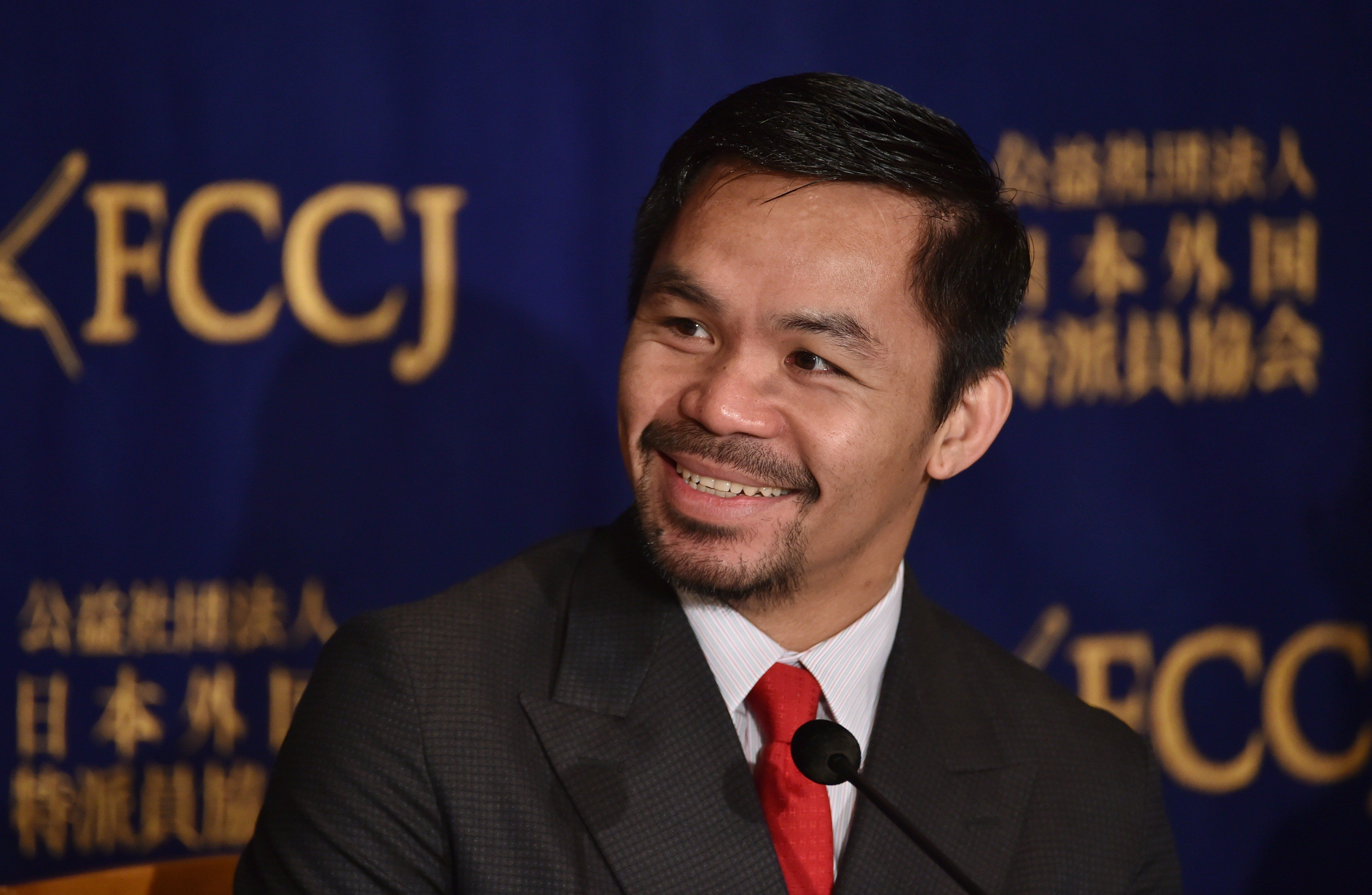 WBO welterweight world champion Manny Pacquiao answers questions during a press conference at the Foreign Correspondents' Club of Japan prior to his press conference in Tokyo on November 26, 2016.  Pacquiao is in Japan to launch his first fitness gym 'PACQUIAO GYM TOKYO JAPAN' in Harajuku, Tokyo. / AFP / KAZUHIRO NOGI        (Photo credit should read KAZUHIRO NOGI/AFP/Getty Images)