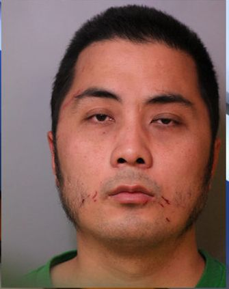 Zhang Huang is accused of attacking his new bosses with a meat cleaver.