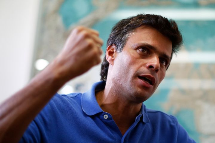 Venezuelan opposition leader Leopoldo Lopez gestures while speaking during an interview with Reuters in Caracas, February 11,
