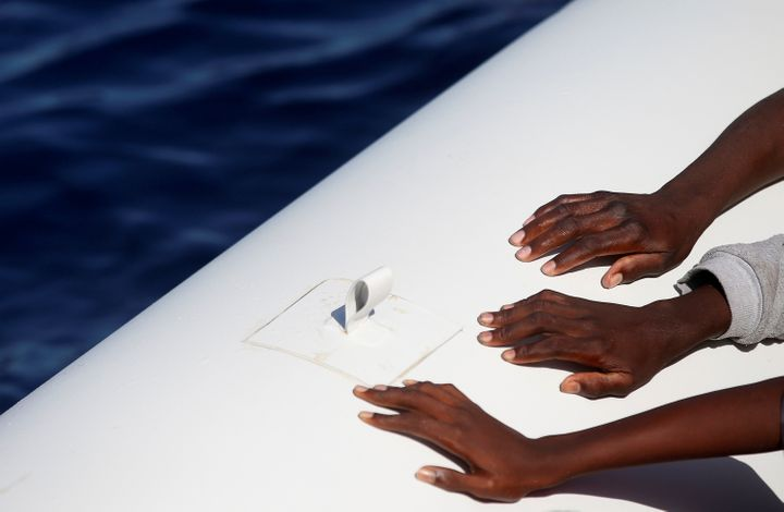 Rescuers saved about 3,000 migrants but found more than 50 dead on boats near the coast of Libya on Wednesday.
