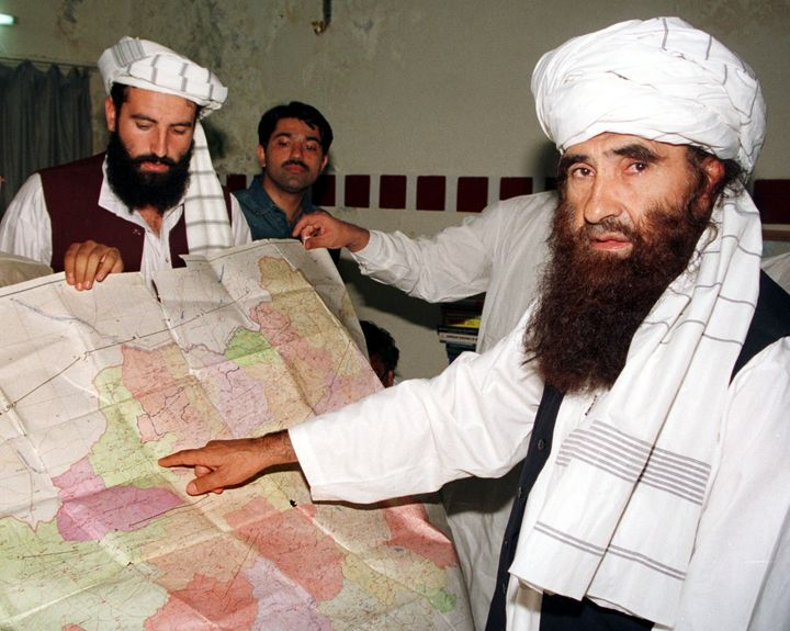 Jalaluddin Haqqani points to a map of Afghanistan during a visit to Islamabad, Pakistan, October 19, 2001.