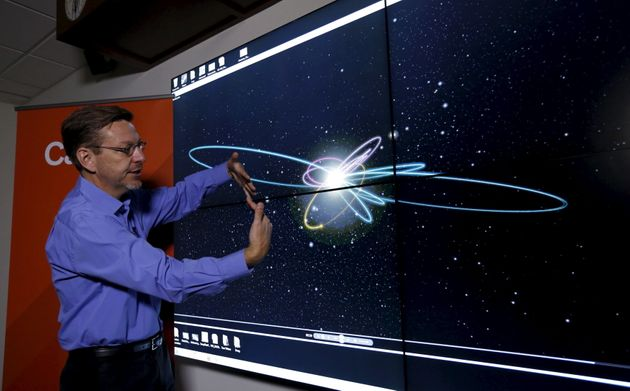 Professor of Planetary Astronomy Mike Brown speaks in front of a computer simulation of the probable...