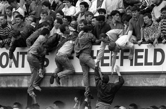 People try to escape the crush at the FA Cup semi-final at Hillsborough, April 15