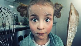 Little girl during a cooking session with flour in her face and trowel and wire whip in her hands.