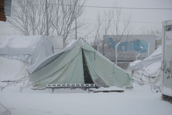 Tents in Softex are covered in snow. People have no protection from the cold.
