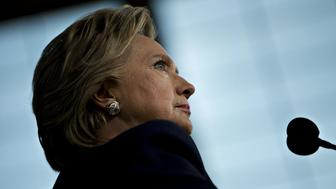 Hillary Clinton, 2016 Democratic presidential nominee, pauses while speaking during a campaign event in Detroit, Michigan, U.S., on Friday, Nov. 4, 2016. As the U.S. presidential race heads into its final weekend, Donald Trump is showing strength in Iowa and Ohio pre-Election Day voting, while Clinton's advantage in early balloting looks stronger in North Carolina and Nevada. Photographer: Daniel Acker/Bloomberg via Getty Images
